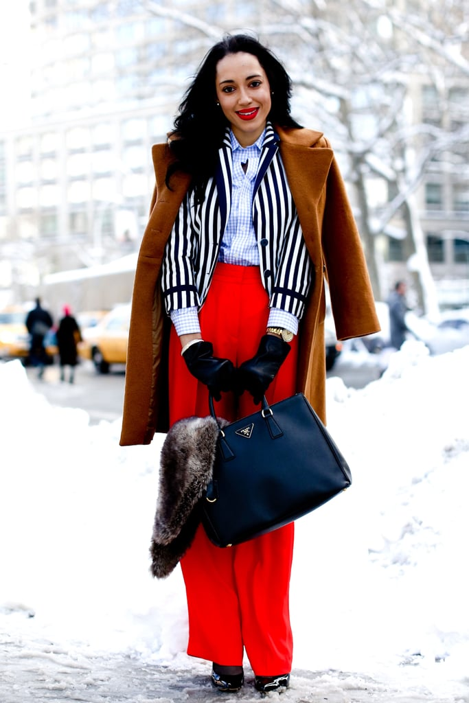 A statement-making mix of stripes, fiery red, and a posh Prada tote.