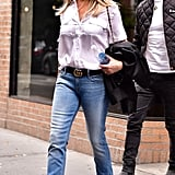 In September 2016, she wore a white button down shirt with flared jeans, a Gucci belt, and Burberry espadrilles.