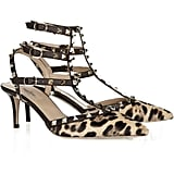 The straps offer support, the kitten heels mean they're easy on your tootsies, and the luxe leopard print and standout studs will add just the right touch to your LBD.  Valentino Studded Calf Hair Kitten-Heel Sandals ($1,075)