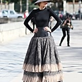 Now this is how you get street snapped: a dramatic floor-length skirt and a ladylike wide-brim hat.