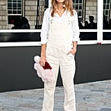 Alexa knows how to mix the high street with the high fashion. On the first day of London Fashion Week, the fashionista chose to wear a Chanel necklace and Birkenstock sandals with her dungaree.