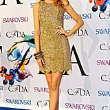 Wearing a Michael Kors dress and Casadei shoes to the 2014 CFDA fashion awards.