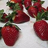 While the chocolate melts, wash the strawberries and pat dry with a paper towel.