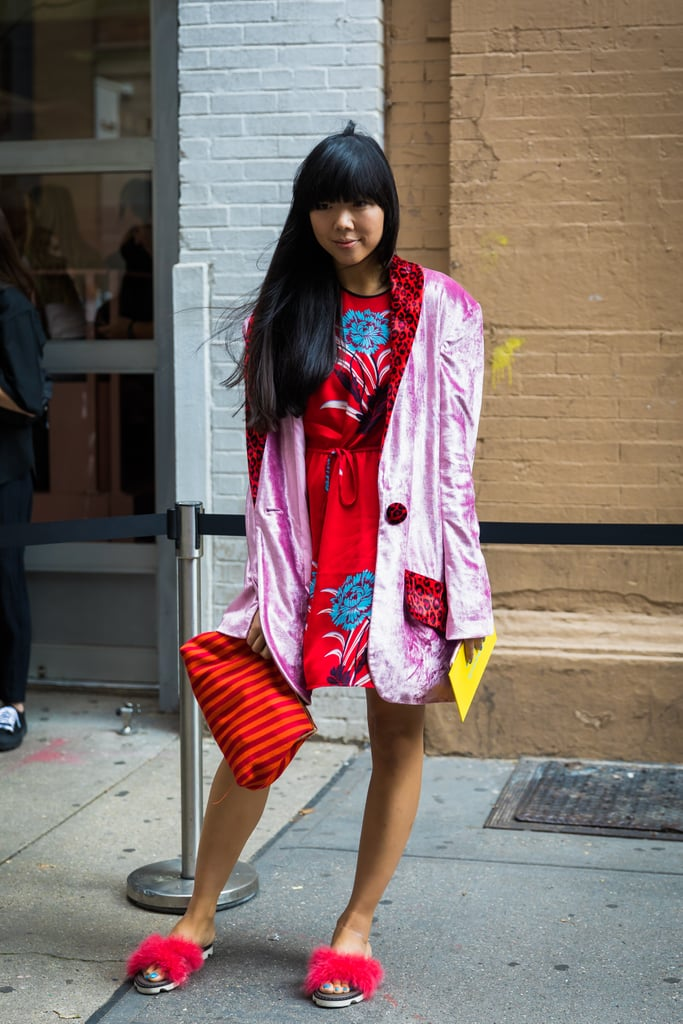 Susie Lau found a balance between red and pink in her outfit with the right accessories.
