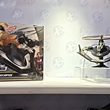 Launch Batman through the air as he battles Superman with his flying Batcopter — perfect for outdoor play.