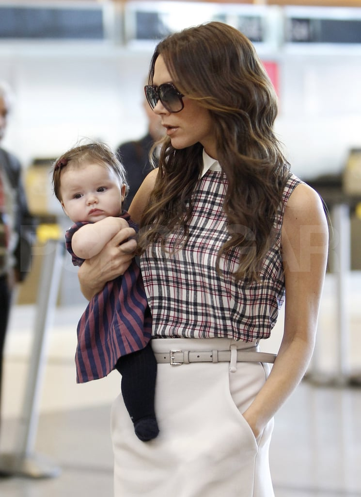 Victoria Beckham and Harper Beckham dressed up to fly.