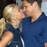 The two couldn't hide their big grins at a Levi's Store Opening Party in July 2003.