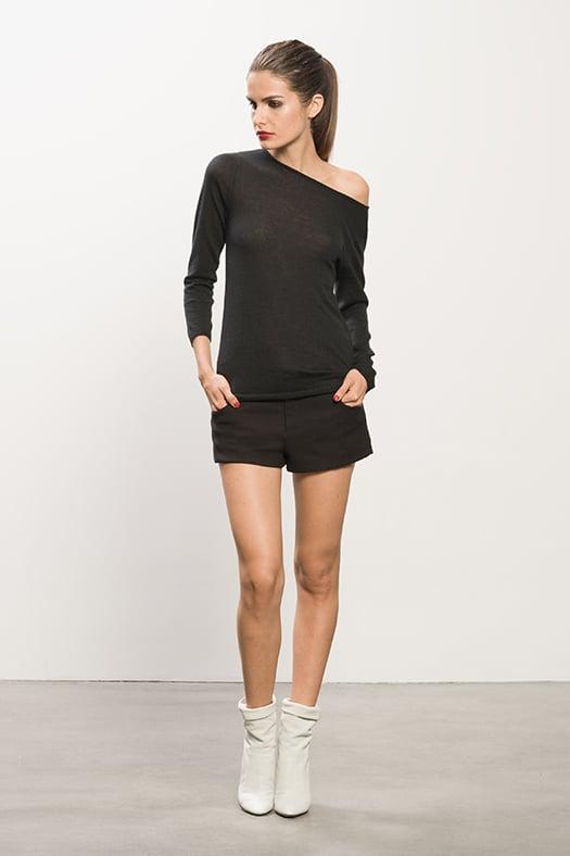 Cashmere Black Sheer Sweater, Pique Black Shorts, Rebel Off White Leather Boots. Photo courtesy of Tamara Mellon
