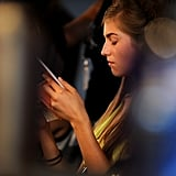 A model was spotted reading backstage during Barcelona's Fashion Week for Spring/Summer 2010 collections.