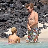 Leonardo DiCaprio went shirtless while spending time on the beach in Hawaii with then-girlfriend Erin Heatherton in July.