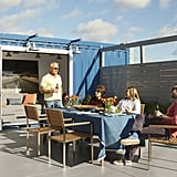 Deciding to put a shipping container on his rooftop was something Anthony always fantasized about doing. He turned it into a cozy hangout by bringing in a sofa and wall-mounted desk and finished it off with an oversize photo he took while traveling.  You can see him enjoying an al fresco meal on the teak patio set with his parents and sister. We can't imagine a better way to spend the Summer!