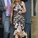 Kate Moss sipped champagne.