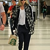 According to Cara, the sneakers are also airport approved. The model wore them with a similar dressed-down outfit consisting of joggers, a white tee, a pink beanie, and a graphic jacket.
