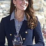 Putting to rest pregnancy rumors, Kate sipped stylishly in a nautical topper at Amisfield Winery.