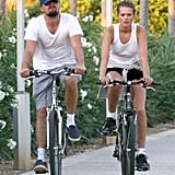 Leo rode a bike through Spain with his latest girlfriend, Toni Garnn, in August 2013.