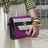 A healthy stack of bangles and a bit of bright purple made for some high-impact add-ons.