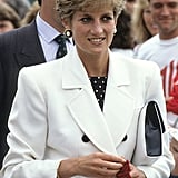 She flashed her signature smile during a tennis match in England in July 1991.