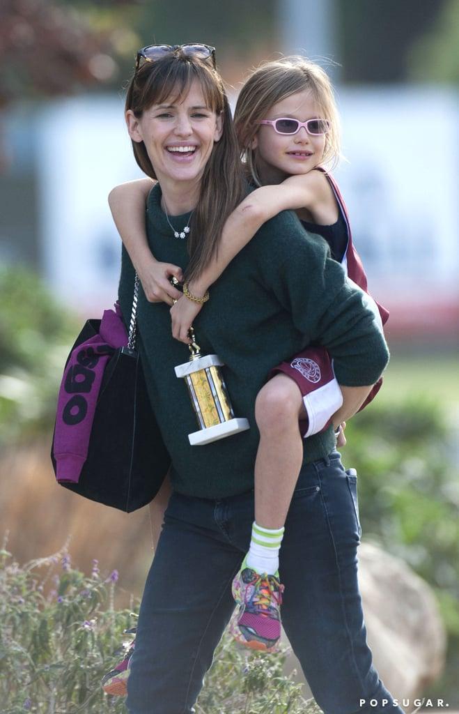 Jennifer Garner gave her daughter Violet a piggyback ride after a trophy-winning basketball game in LA on Sunday.