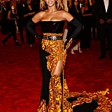 Beyoncé had a sizzling moment in her Givenchy Haute Couture by Riccardo Tisci flame-detailed skirt and matching over-the-knee boots. She added further glitz with Lorraine Schwartz jewels.