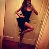 Chrissy shared a sexy selfie, showing off her stems in a dress with a high slit. Source: Instagram user chrissyteigen