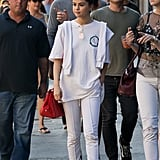 It was all about white, casual vibes for Selena when she wore Cotton Citizen pants, Louis Vuitton sneakers, and a Coach bag.