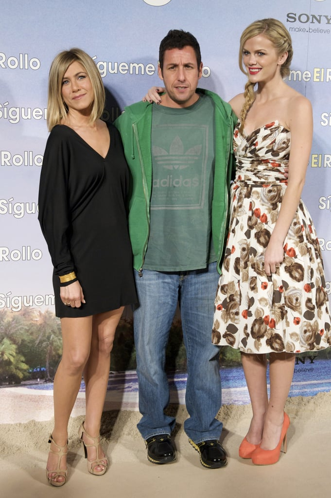 Jennifer Aniston and Brooklyn Decker changed into dresses for the premiere of Just Go With It in Madrid last night while their costar Adam Sandler stuck with his casual outfit from the photo call earlier in the day. Jennifer debuted her short bob at the event, and you all seem to be excited about the new style, which inspired Bella to take a look back at her different cuts through the years. Jennifer, Brooklyn, and Adam have been on the road promoting their movie since the NYC premiere earlier this month, and they're pushing through jet lag to continue their press duties.
