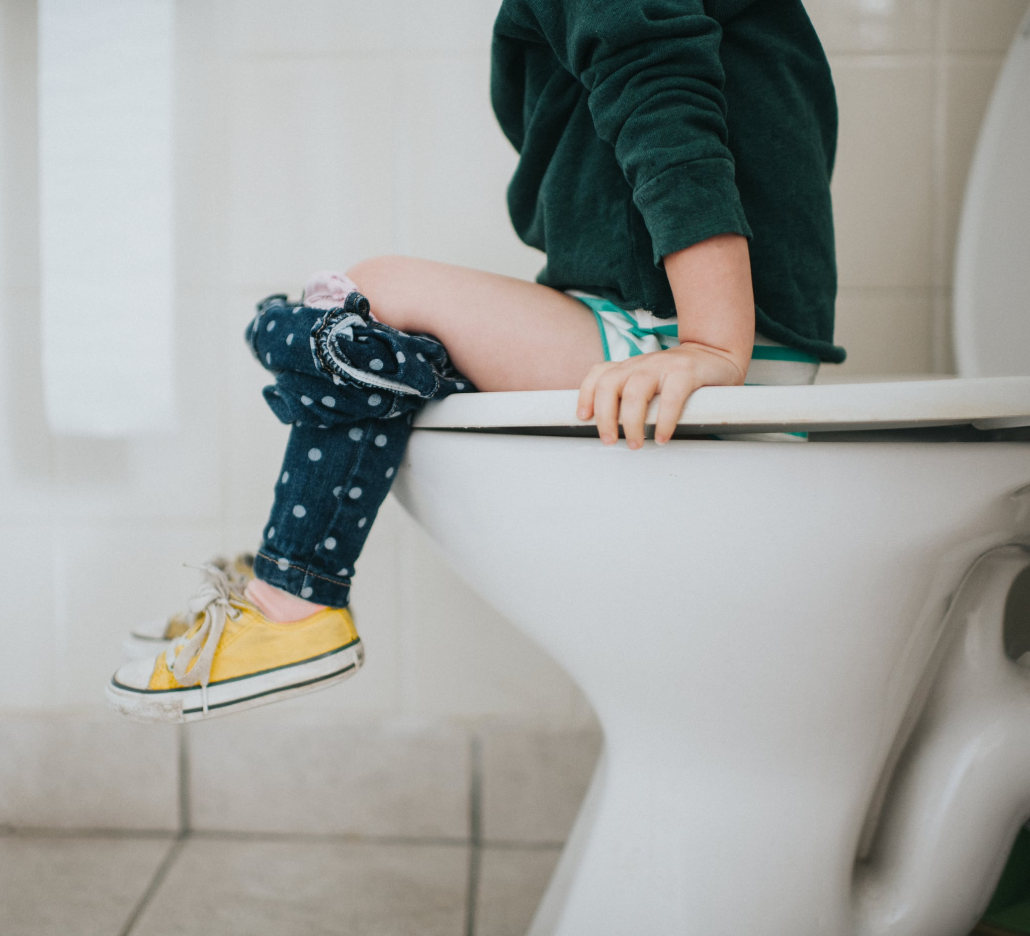 Small child on a toilet