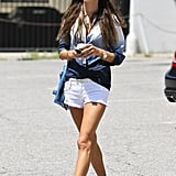 Alessandra Ambrosio wore white denim shorts and sandals.