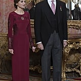 A Long-Sleeved Burgundy Gown With Lace Details From Felipe Varela