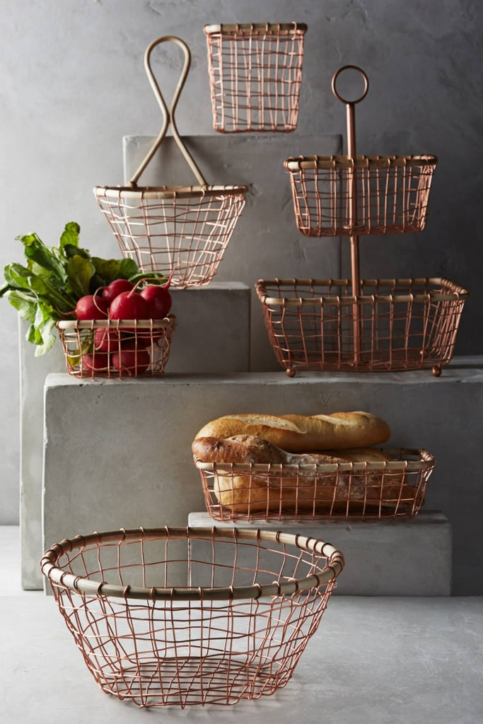 Fruit, mail, towels; whatever you put in these brushed wire storage baskets ($12-68) will look beautiful.