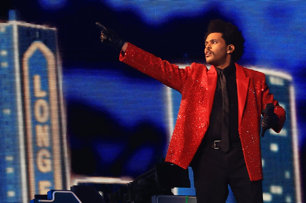 """The Weeknd gave us everything we wanted and more during his Super Bowl LV performance at Raymond James Stadium in Tampa, Florida, on Sunday. As the first-ever Canadian to headline solo, he made it a performance we'll never forget.  He kicked things off with """"Starboy"""" before transitioning into the hits """"The Hills,"""" """"Can't Feel My Face,"""" and """"I Feel It Coming."""" The Weeknd made sure to do things big, as he took his performance onto the field amongst a sea of bandage-wearing dancers while singing """"Blinding Lights."""" One thing that's for certain: The Weeknd knows how to put on a show, and we can't wait to see what the rest of 2021 holds in store for the After Hours singer. Relive some of the best moments from his performance ahead!      Related:                                                                                                           The Weeknd's Super Bowl Halftime Show Was Iconic, Mind-Blowing, Historic — Shall I Go On?"""