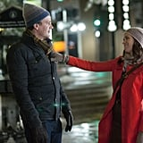 She continues her love affair with red in a red coat, finished with a slouchy beanie and gloves.