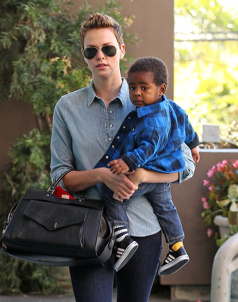 Charlize Theron dressed her son, Jackson, in a blue flannel shirt to make a stop at at children's gym in LA.