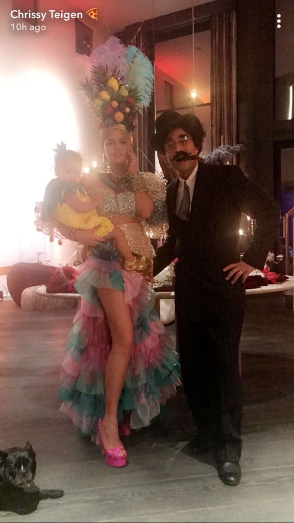 Chrissy Teigen and John Legend went all out for their Halloween costumes this year. The sickeningly sweet couple, who tied the knot in September 2013, paid homage to the 1947 musical comedy Copacabana by dressing up as Carmen Miranda and Groucho Marx. Not only was the model's flashy headdress full of fruity details, but they even dressed their daughter Luna up as a pineapple to complete the group costume. After posing for a family photo at home, the pair continued the festivities at their Halloween party in LA by snapping a few pictures in the photo booth. Seriously, this might top Luna's adorable pop-culture costumes from last year.       Related:                                                                                                           We're Already Blown Away by These Celebrity Halloween Costumes