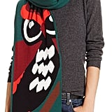 I'm all about accessorizing my puffers and wool toppers with furry stoles, but for my other coats? I'm digging Kate Spade's Owl-Printed Scarf  ($228), which will surely make a statement while keeping me warm.  — SS