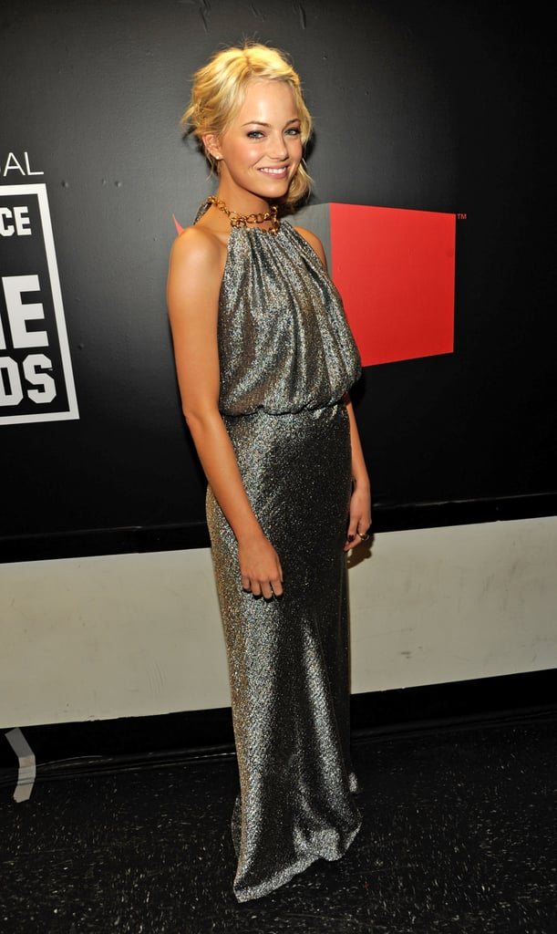 We love the look of metallic for evening; Emma stunned in this silvery Balenciaga gown at the 2011 Critics' Choice Awards.