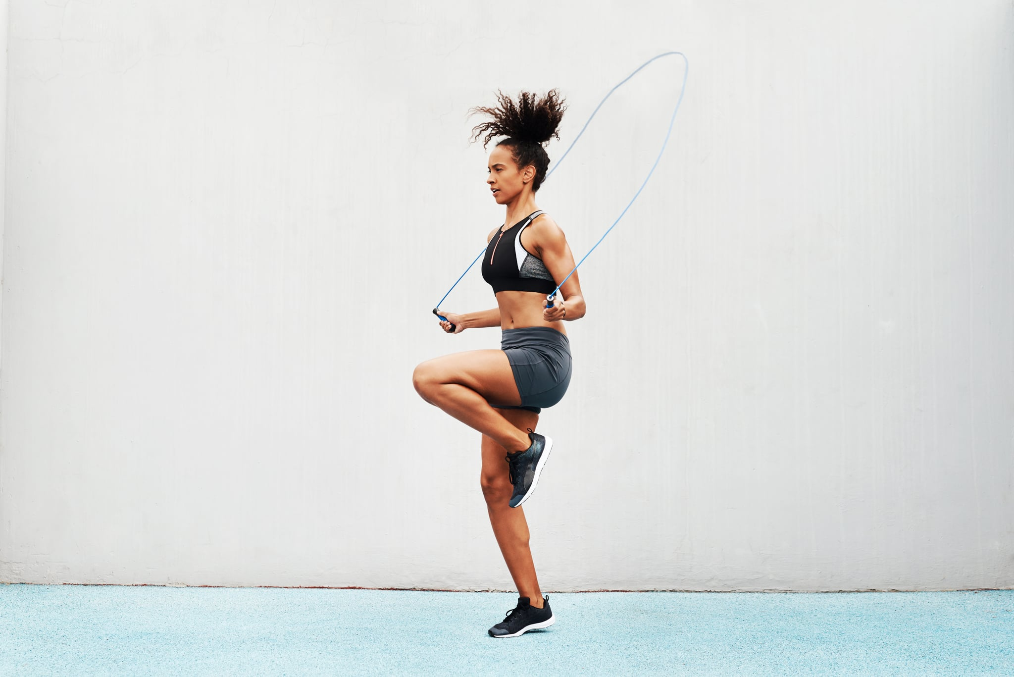Full length shot of an attractive young athlete using a skipping rope during an outdoor training session