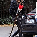 Liv Tyler wore black tights and a feathered jacket while trick-or-treating with her son in 2010.