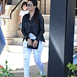 Kourtney topped skinny white distressed jeans with the ultimate cool-girl motorcycle jacket. The result is a little sexier than your average Summer button-down.