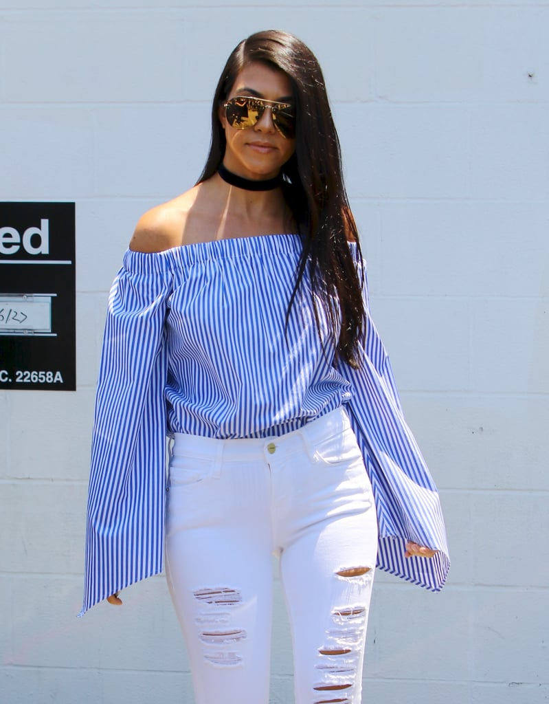 In a Striped Off-the-Shoulder Top and White Jeans