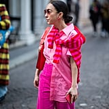 Neon shades are big this season and what better way to accent a head-to-toe look than with a striped top tied around your shoulders?