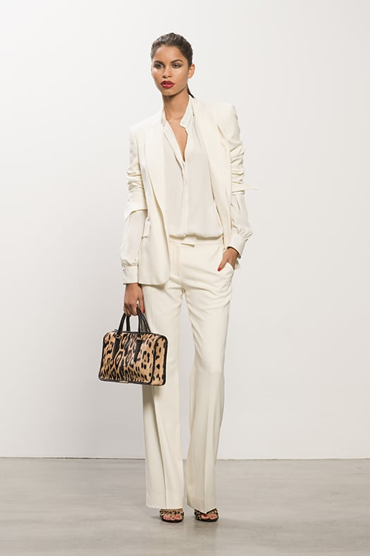 Classic Cream Wool Pique Blazer ($795), Classic Cream Wool Pique Trouser ($595), Georgette Cream Long Sleeve Blouse ($350), Wild Night Leopard Pony Sandal ($750), Diglam Leopard Pony Satchel ($1,195) Photo courtesy of Tamara Mellon