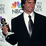 Tom Cruise proudly held up his Golden Globe in 1997.