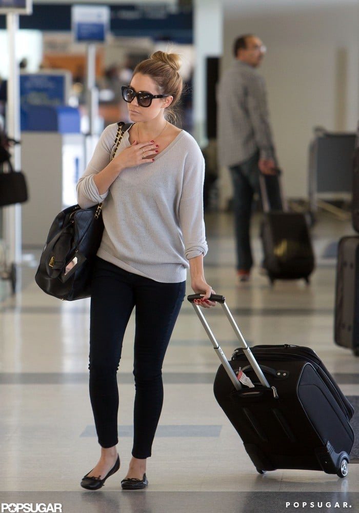Lauren Conrad headed toward the check-in counter at LAX on her way out of town on Sunday. Since she is frequently on the go, Lauren launched an eco-friendly travel bag line ranging from a place to keep your makeup brushes to a weekender for your next getaway. It's just the latest in Lauren's many business ventures and her Paper Crown fashion line — she's also working on her next book tour, which kicks off this Fall. In between everything, Lauren still has time for her new love William Tell. She snuck in a bikini-filled getaway to Cabo with William just a couple weeks ago.