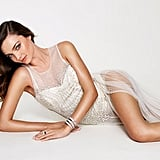 Miranda Kerr wore a lacy, see-through dress for one pose.