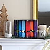 Decorate your mantel with Harry Potter books, candles, and owls.