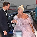For the red carpet premiere of A Star Is Born in Venice, Bradley showed off his chivalry by helping Gaga out of her car.