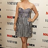 January Jones was flirty in a strapless number with mis-matched prints at the Vanity Fair and Maybelline pre-Emmys party in honour of Mad Men.