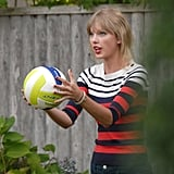 Taylor Swift played volleyball at the Kennedys' sporting a cute striped Shoshanna sweater.
