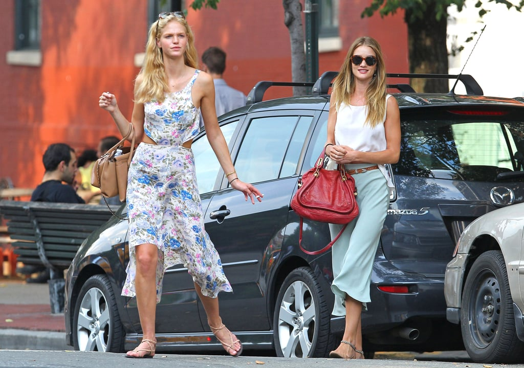 Rosie Huntington-Whiteley and Erin Heatherton stepped out for lunch at Bar Pitti in NYC yesterday. The two Victoria's Secret Angels spent a long weekend together in the Big Apple, with Erin updating her Twitter with cute pictures of the modeling twosome's adventures from watching the sunset to popping into a photo booth. Rosie flashed a small sliver of her toned tummy during her outing with Erin yesterday, and the Transformers: Dark of the Moon's amazing figure is serving her well in our bikini bracket. Rosie Huntington-Whiteley's bikini body also landed her on our list of the seven hottest models in competition this year, alongside even more current and former VS girls like Miranda Kerr and Gisele Bundchen.
